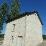façade en pierre apparente enduit à la chaux